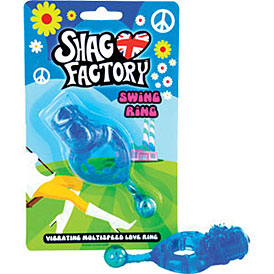 "The Shag Factory Swing Ring lays beside the toy's packaging, which is bright blue and green and has peace signs and daisies all over it, along with the logo ""Shag Factory"" beside a heart with the Union Jack flag in it, and ""Swing ring"" below that. Visually it's basically supposed to leave you with the same level of horror that the Austin Powers movies do."