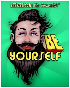 """Shevibe banner captioned """"Be Yourself"""" featuring a person with brunette short hair and a long beard with a curly mustache, wearing what appears to be red lipstick and some eyeshadow."""