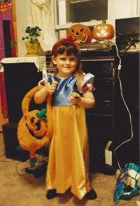 Sugar on Halloween 1994, dressed up as Snow White and carrying a cloth pumpkin to collect candy in