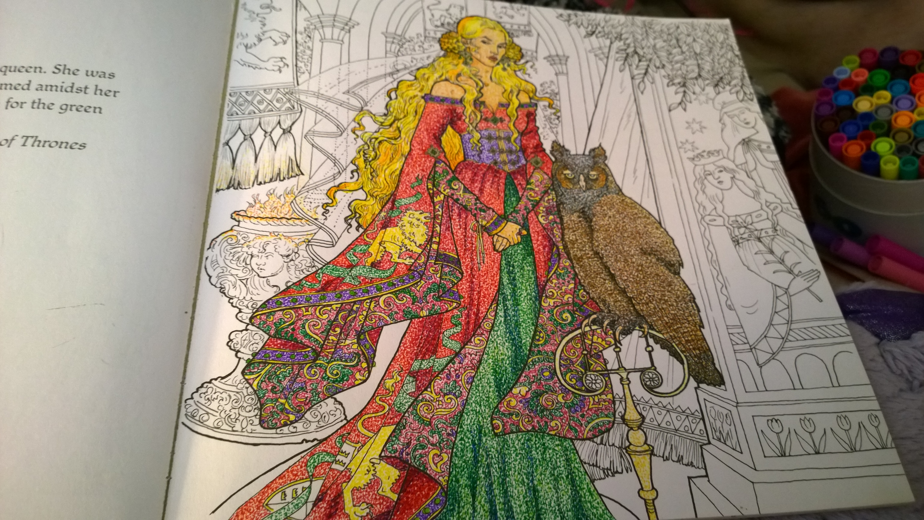 Photo of a page in the Game of Thrones coloring book, featuring Cersei and an owl. Cersei and the owl are stippled, but much of the background has yet to be colored in