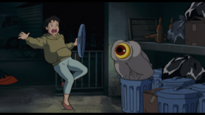 Screenshot from Pom Poko of a shirime (body with eye for an anus) coming out of a trash can and startling a woman.