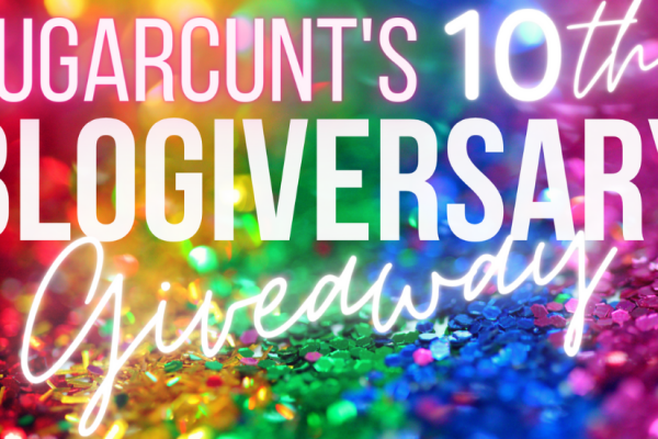"""A background of sequins, sorted into the colors of the rainbow, is covered by glowing lettings announcing: """"Sugarcunt's 10th blogiversary giveaway"""""""
